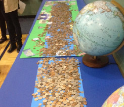 Girls Scouts in Carmel IN gather coins to create a river of change